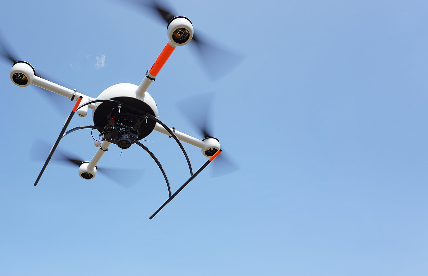 Microdrones md4-1000 UAV with mdMapper payload in flight.