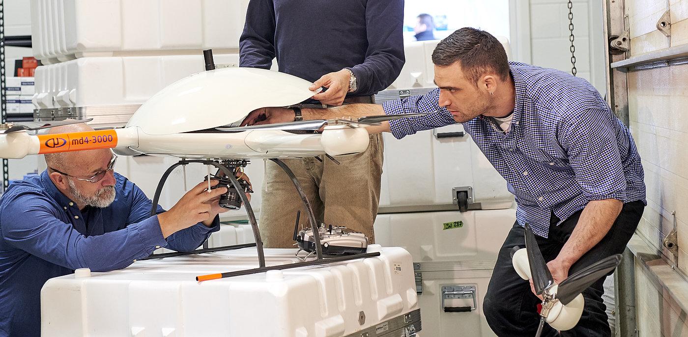 Microdrones staff preparing a new md4-3000 UAV for a flight.