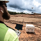 Surveying specialist using a Microdrones md4-3000 mdLiDAR3000 to perform a Laser scan of a construction site